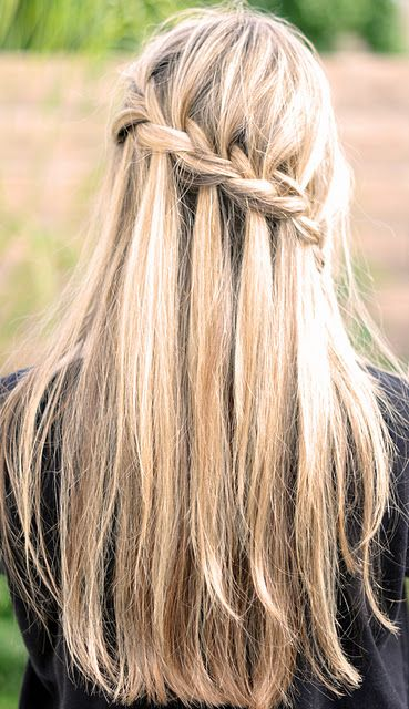 Beautiful waterfall braid. Love how the blonde shades make this style stand out!