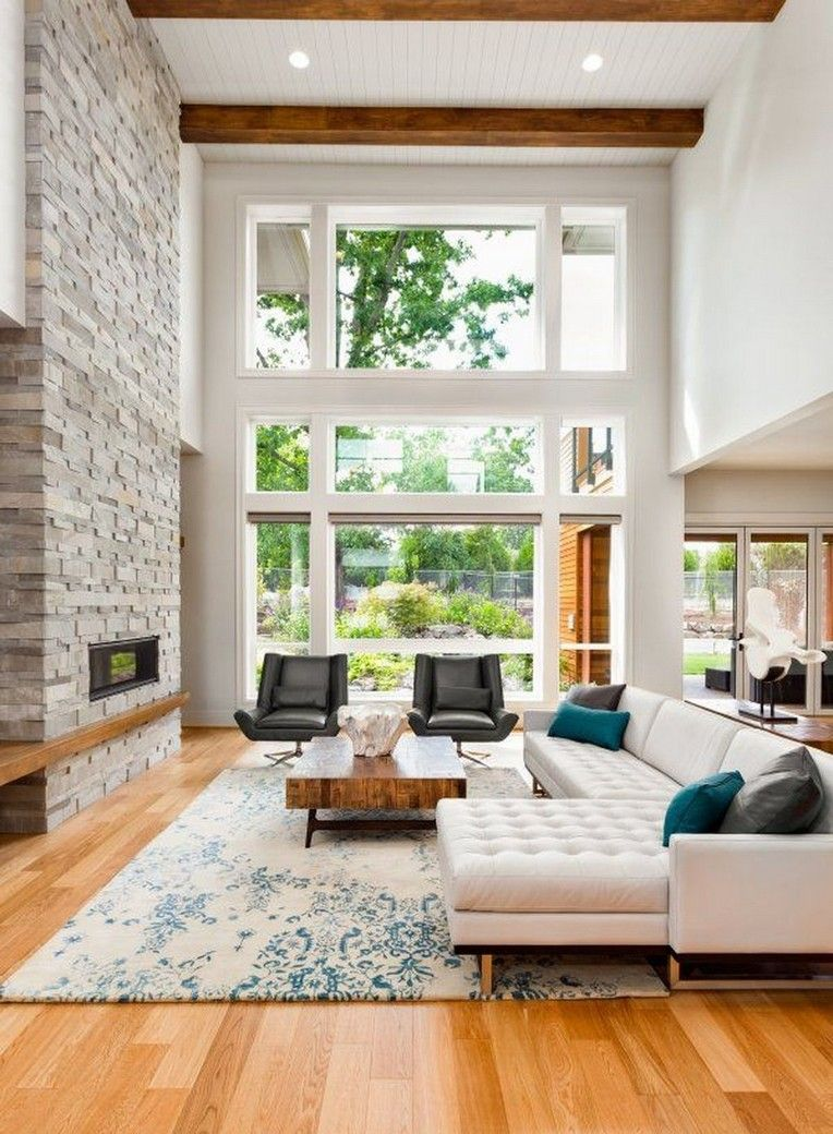 44 Amazing Living Room With Stone Wall Design Ideas Modern White Living Room High Ceiling Living Room Rustic Living Room #stone #wall #living #room #ideas