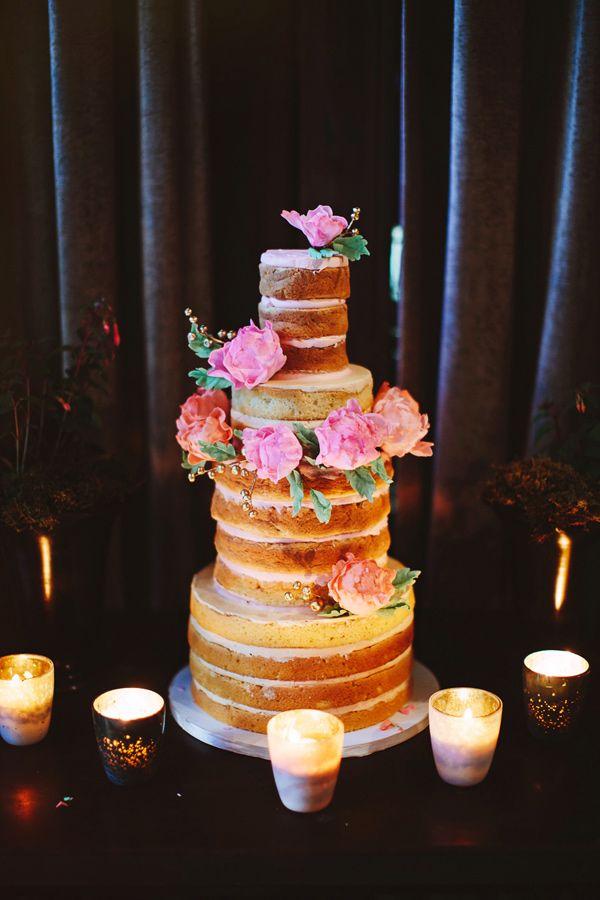 naked wedding cake topped with flowers, photo by Pat Furey http://ruffledblog.com/brooklyn-wedding-with-breathtaking-floral-design #weddingcake #cakes