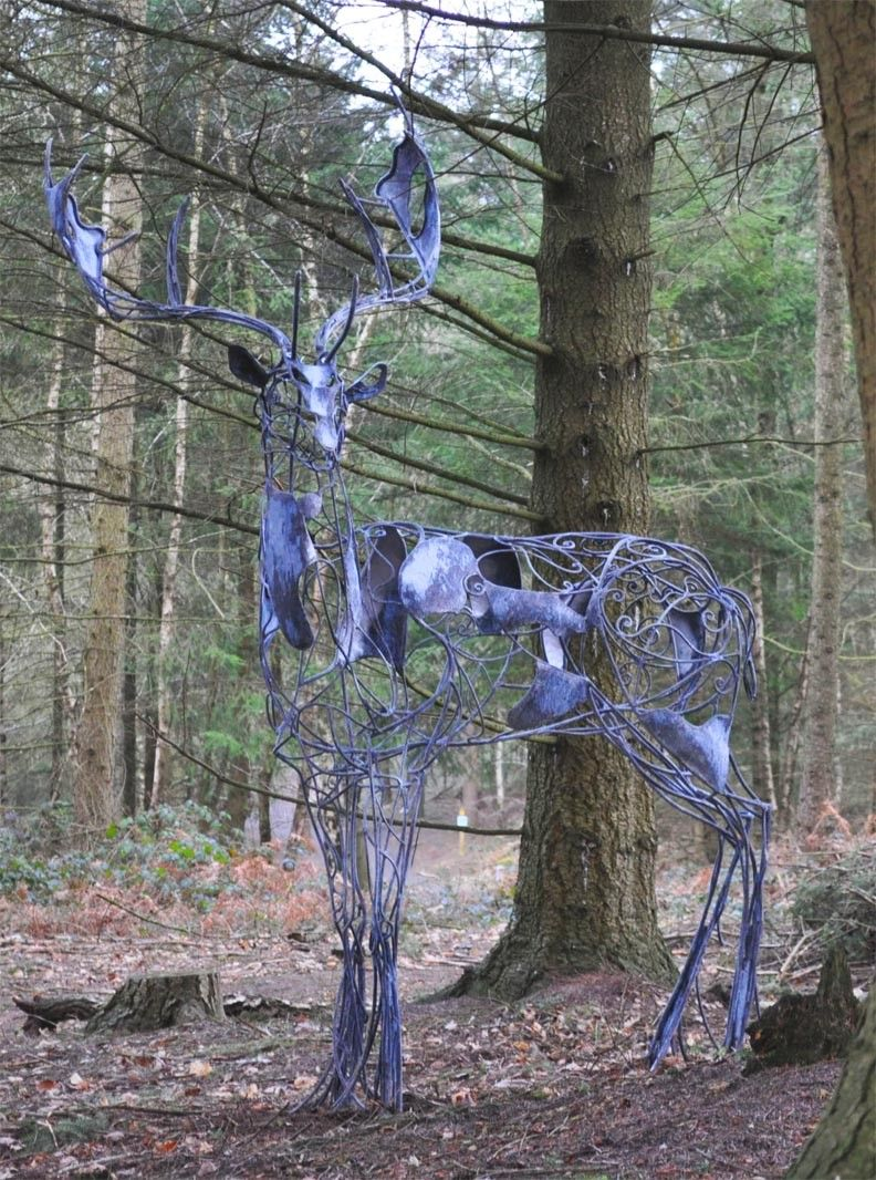 Ghostly Deer Sculpture Stands Deep In A Uk Forest Fallow