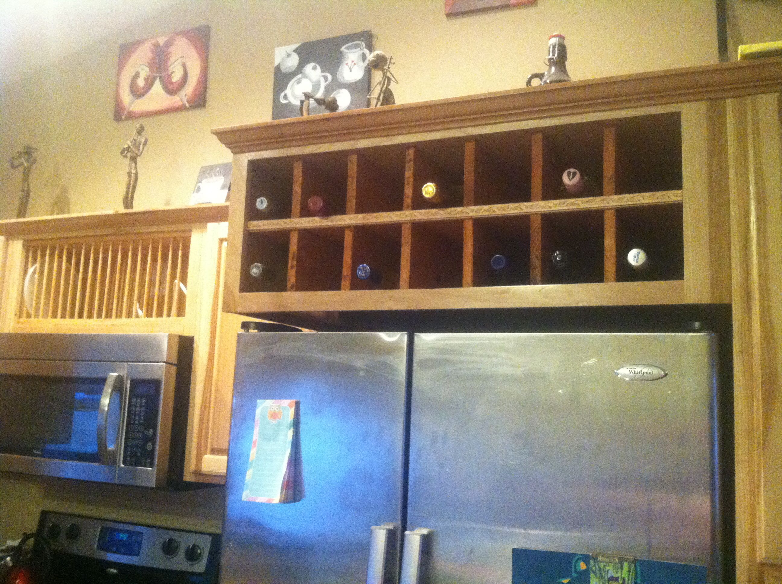 I replaced the cabinet above the fridge with a wine rack and the one