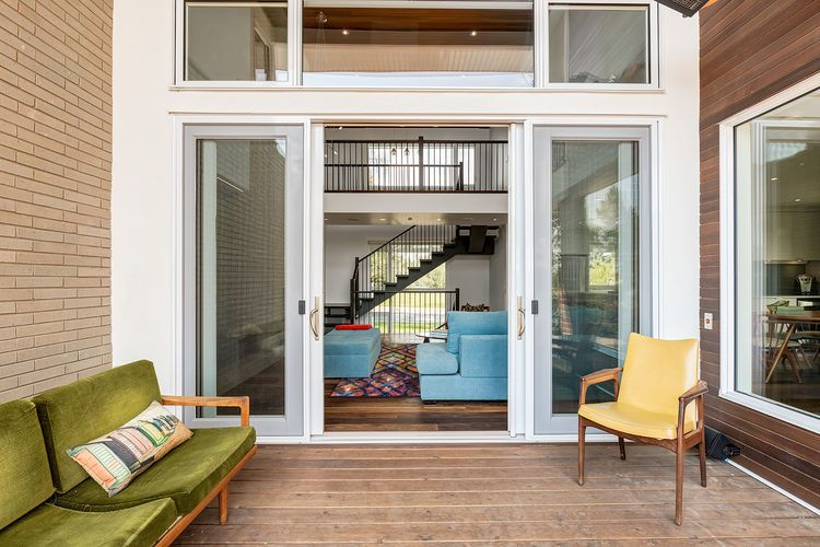Patio With Vintage Furniture In Calgary Home By Doodl Home