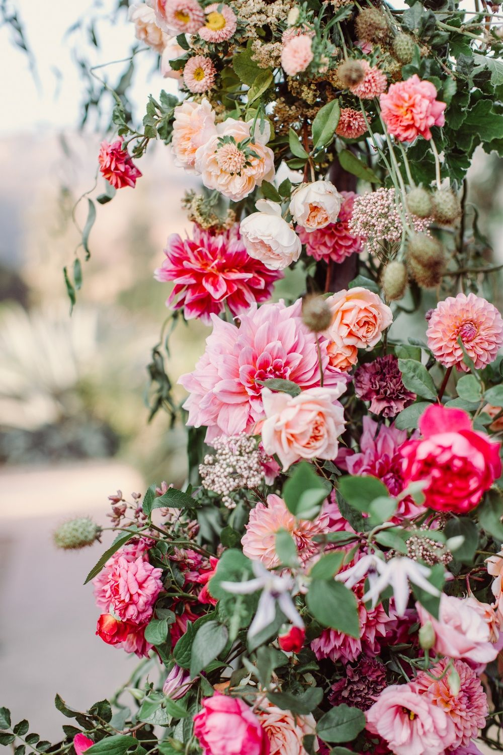 Calling All Flower Lovers This Vibrant Ombre Flower Arch Serves As The Prettiest We Fuchsia Wedding Flowers Floral Wedding Inspiration Wedding Bridal Bouquets