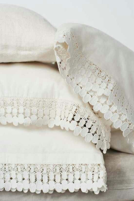 Scrap Lace or Embellishments (from fabric stores who have tons for under a dollar) + 3 dollar Wall Mart Pillowcase = Loveliness!  And you don't have to Sew just use fabric glue instead!