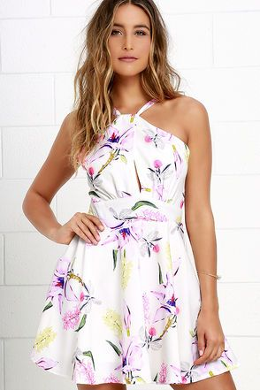 Every occasion is an opportunity to show off the Bali Blooms Ivory Floral Print Dress! Woven poly features pink, purple, and yellow floral print as it shapes a halter bodice that tucks into a set-in waist above a skater skirt. Adjustable straps loop through a keyhole neckline and tie at back. Hidden back zipper.