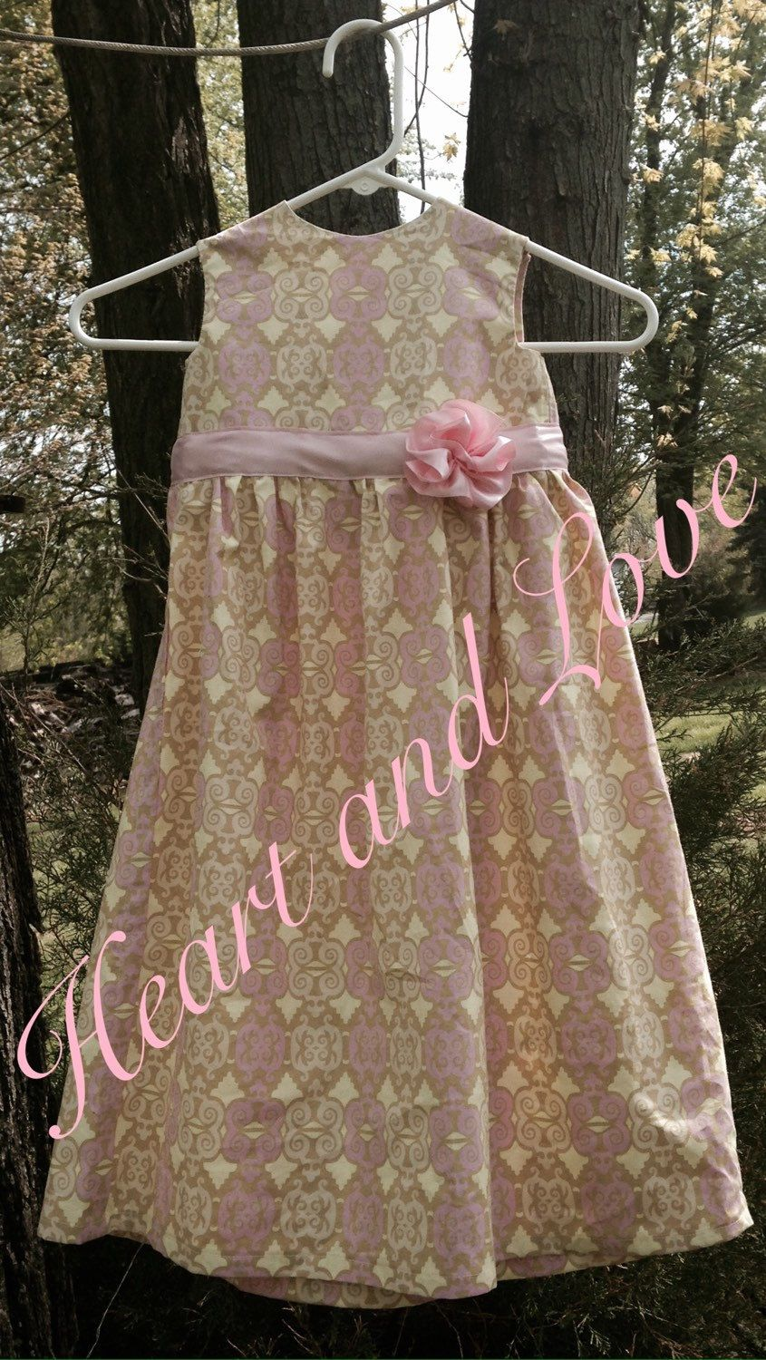 A personal favorite from my Etsy shop https://www.etsy.com/listing/231820153/pink-and-olive-little-girls-dress-with