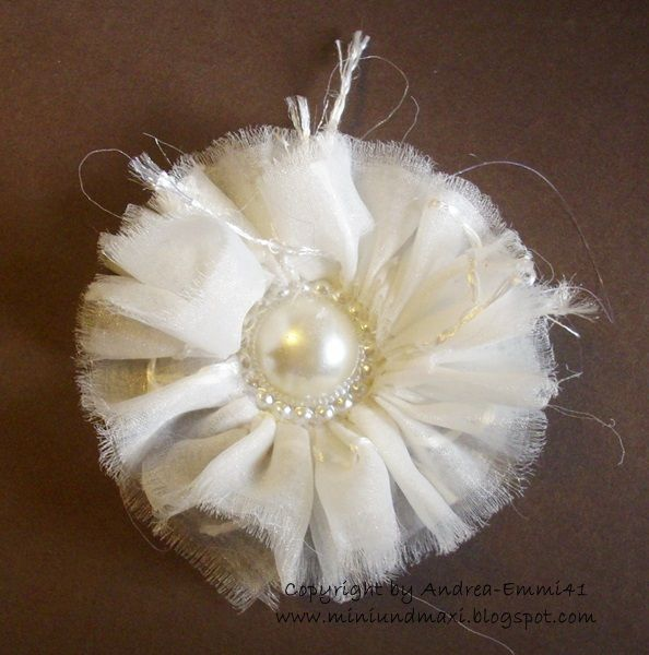 easy to do fabric flower, stitch and hot glue it.