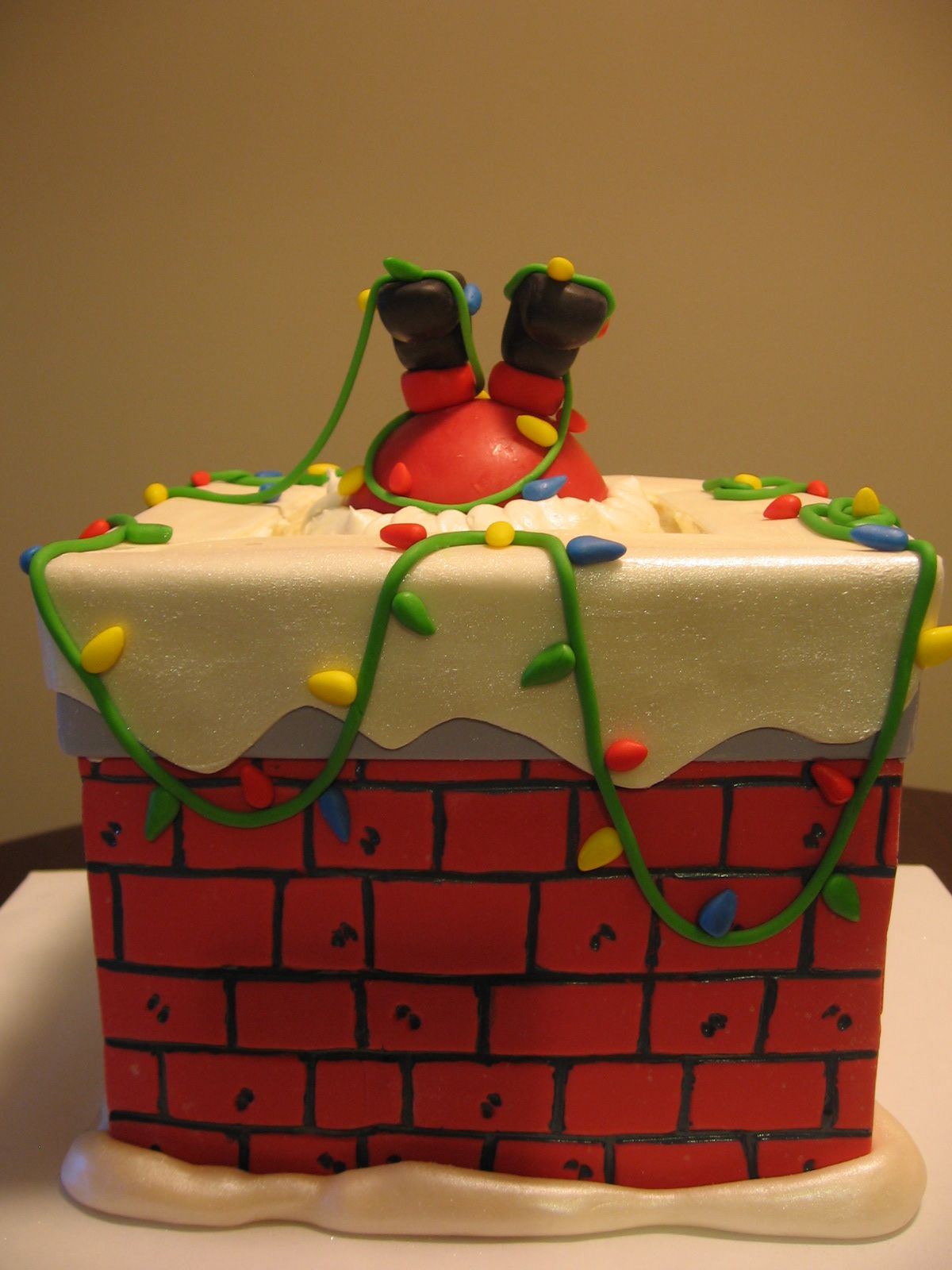 When Santa Got Stuck In The Chimney Top Christmas Cake: santa stuck in chimney cake
