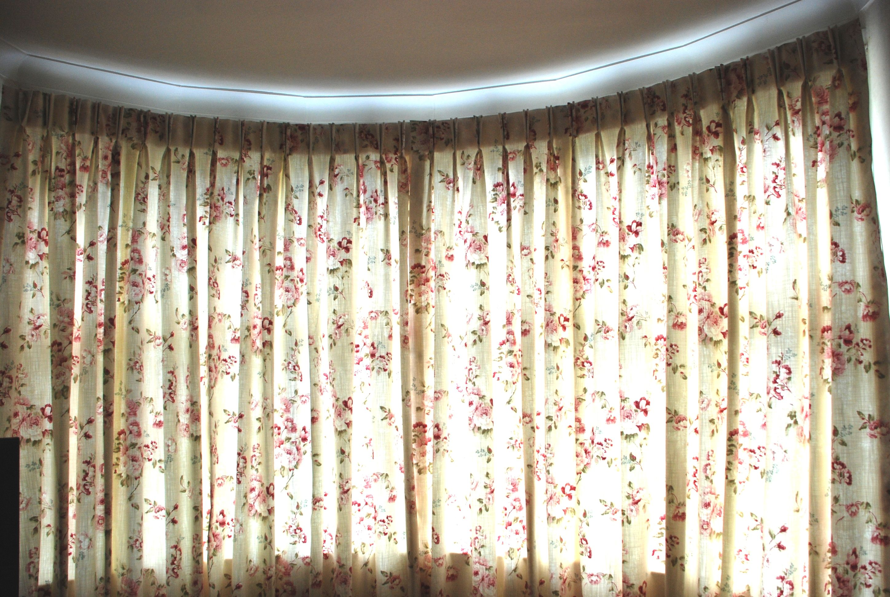 Curved bay window curtains with double pinch pleat and