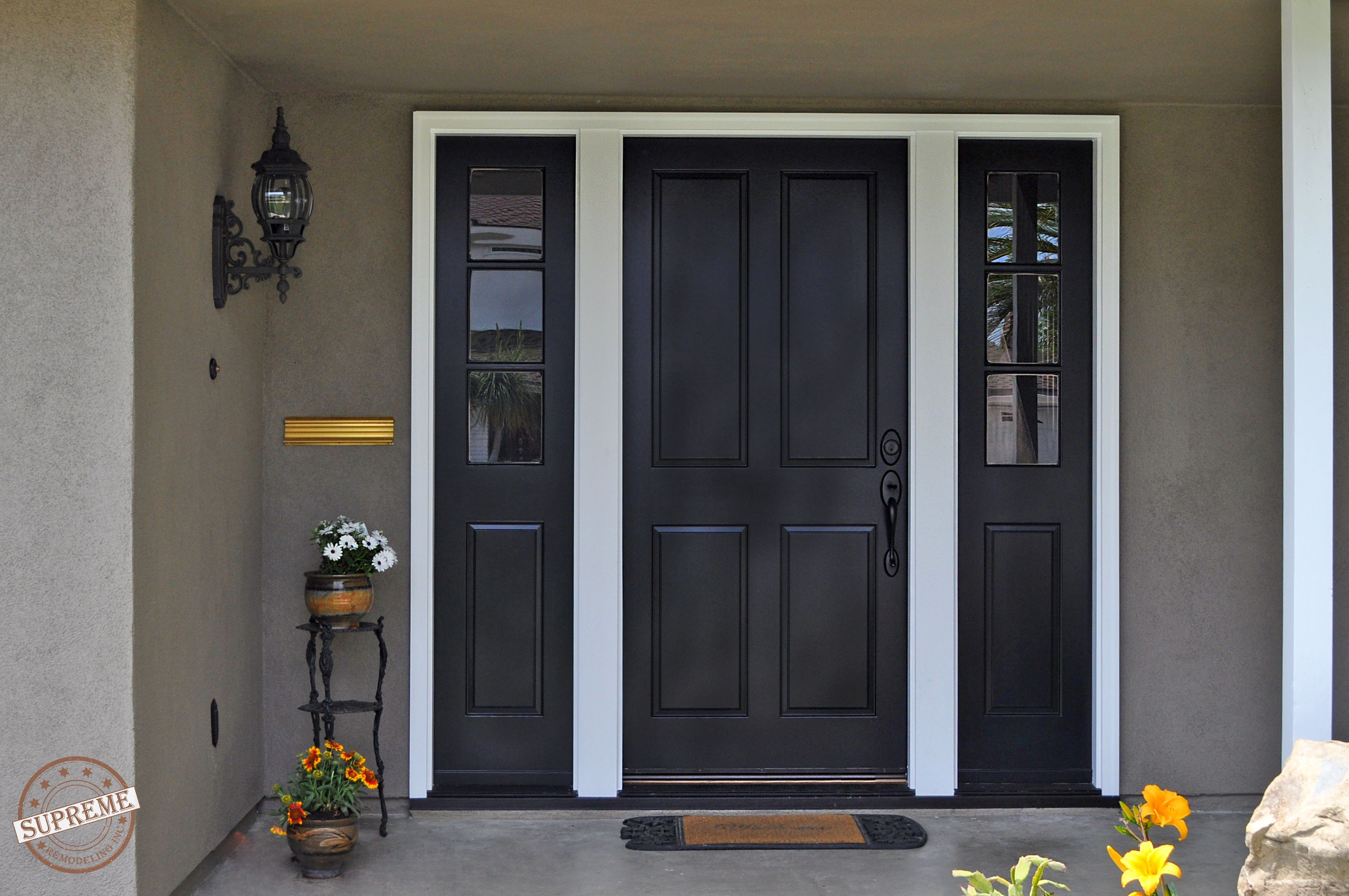 A Simple And Sophisticated Entry With A Black Paneled Door There Is One Scrolled Metal And Glass Wall Sc Stucco House Colors House Paint Exterior Stucco Homes