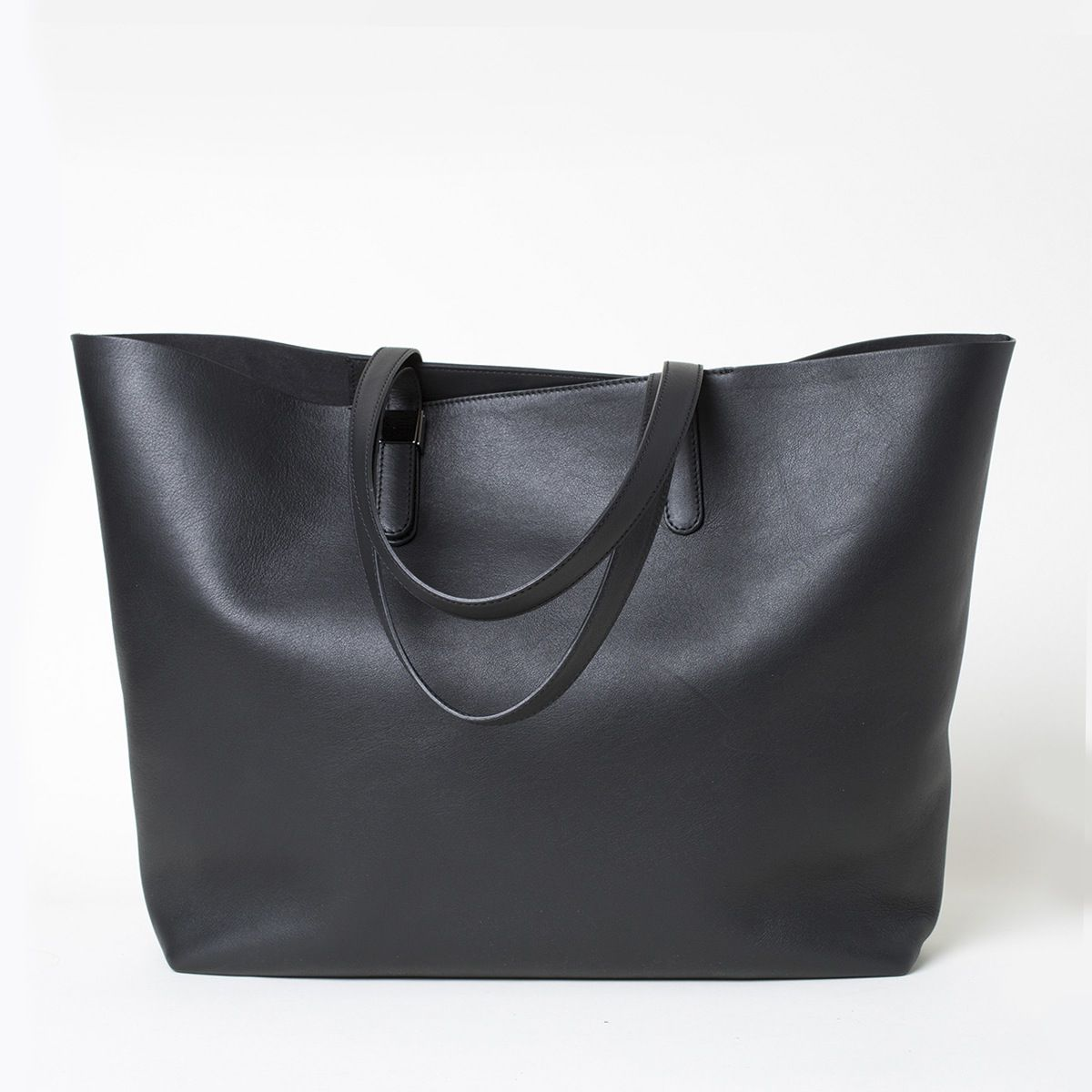 An elegant take on the go-everywhere tote 100% Italian leather exterior Features…