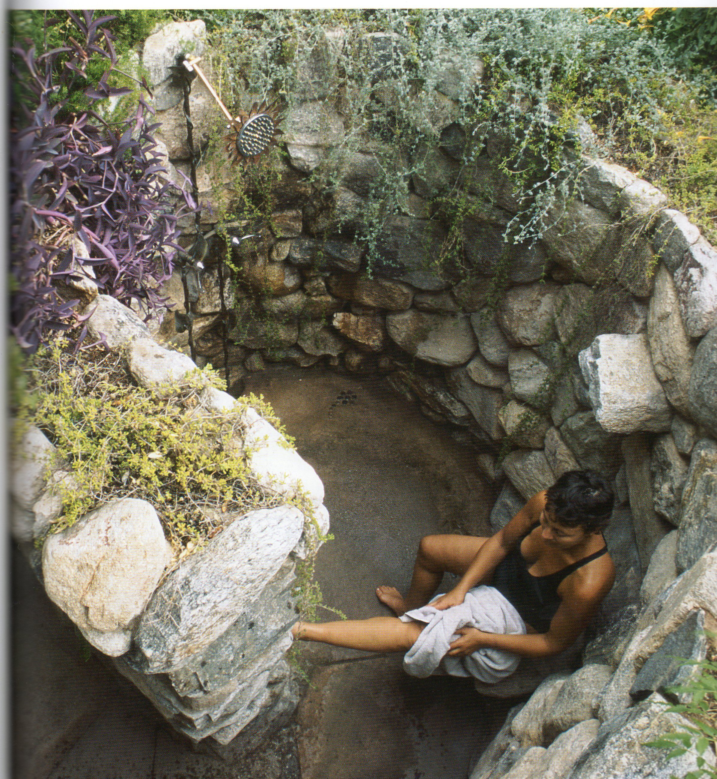 Outdoor shower love this rock walled shower shower ideas for Outdoor rock shower