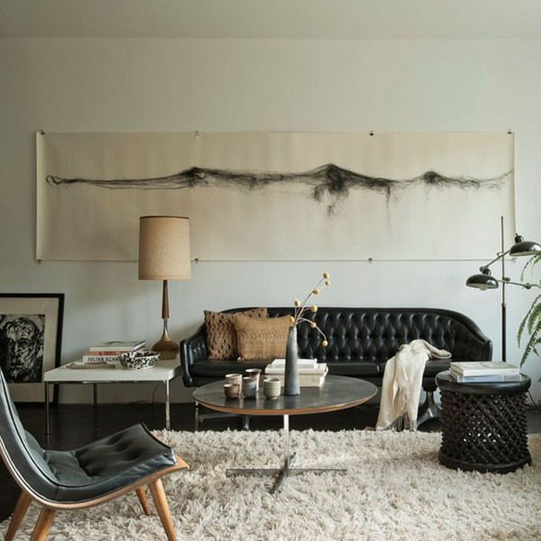 sumptuous design ideas decorating with dark leather couches. minimalistic but yet still lived in chic  matthew williams cream shag rug with black leather sofa couch green plants neutral natural wood Must try my carpet