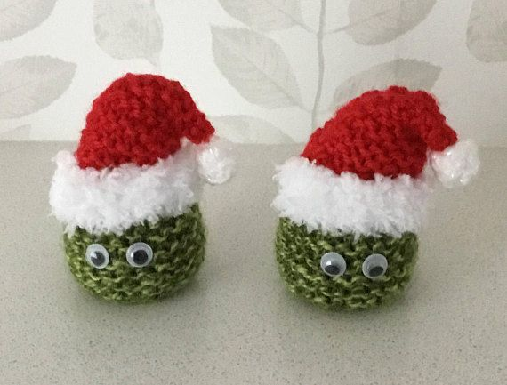 Am selling a set of two Brussel Sprout Santa covers for ferrero rocher  chocolates. Hand knitted at home with green wool and a red Santa hat. 56e28610314