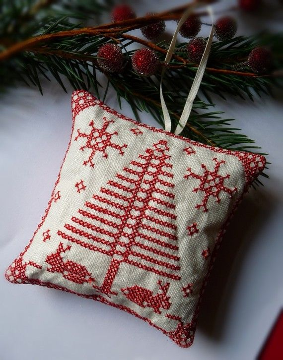 Hey, I found this really awesome Etsy listing at http://www.etsy.com/listing/62812562/cross-stitched-folk-art-ornament-rabbits