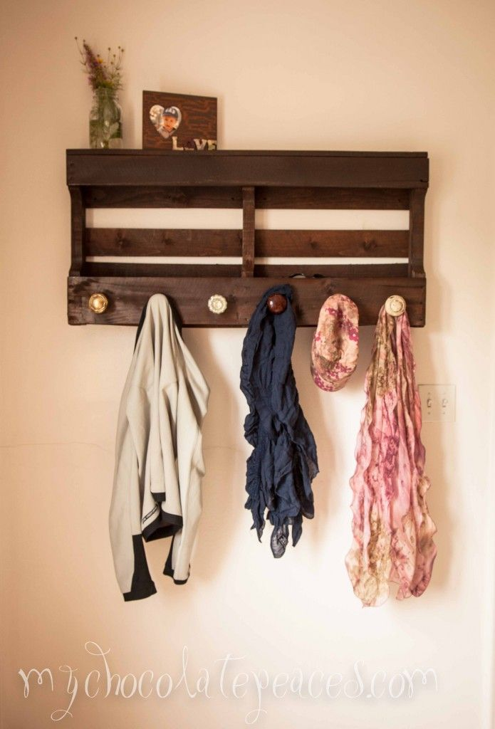 Make A Coat Rack With Shelves Out Of A Pallet And Some Old Door Knobs.