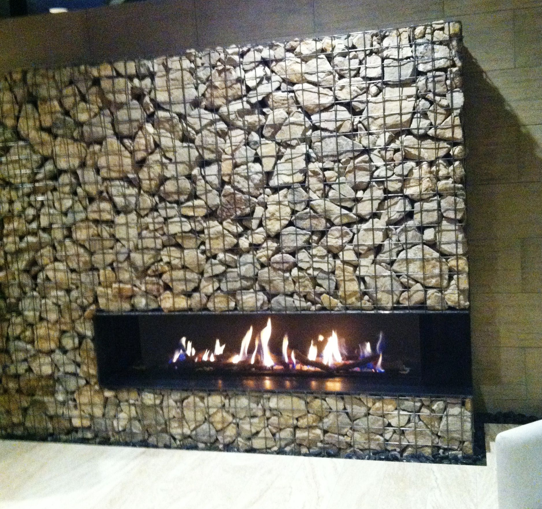 Gabion fireplace wall at the new american home in las for Gabions phoenix
