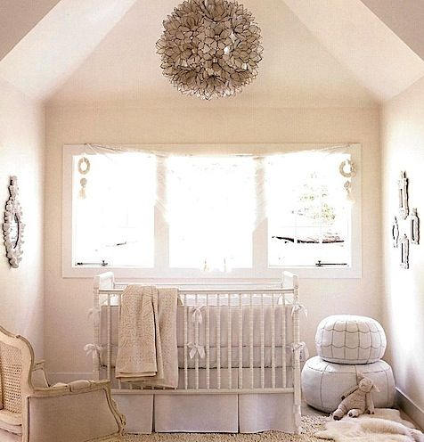 love this white nursery with the amazing lamp and the white leather pouf from Serena and lily