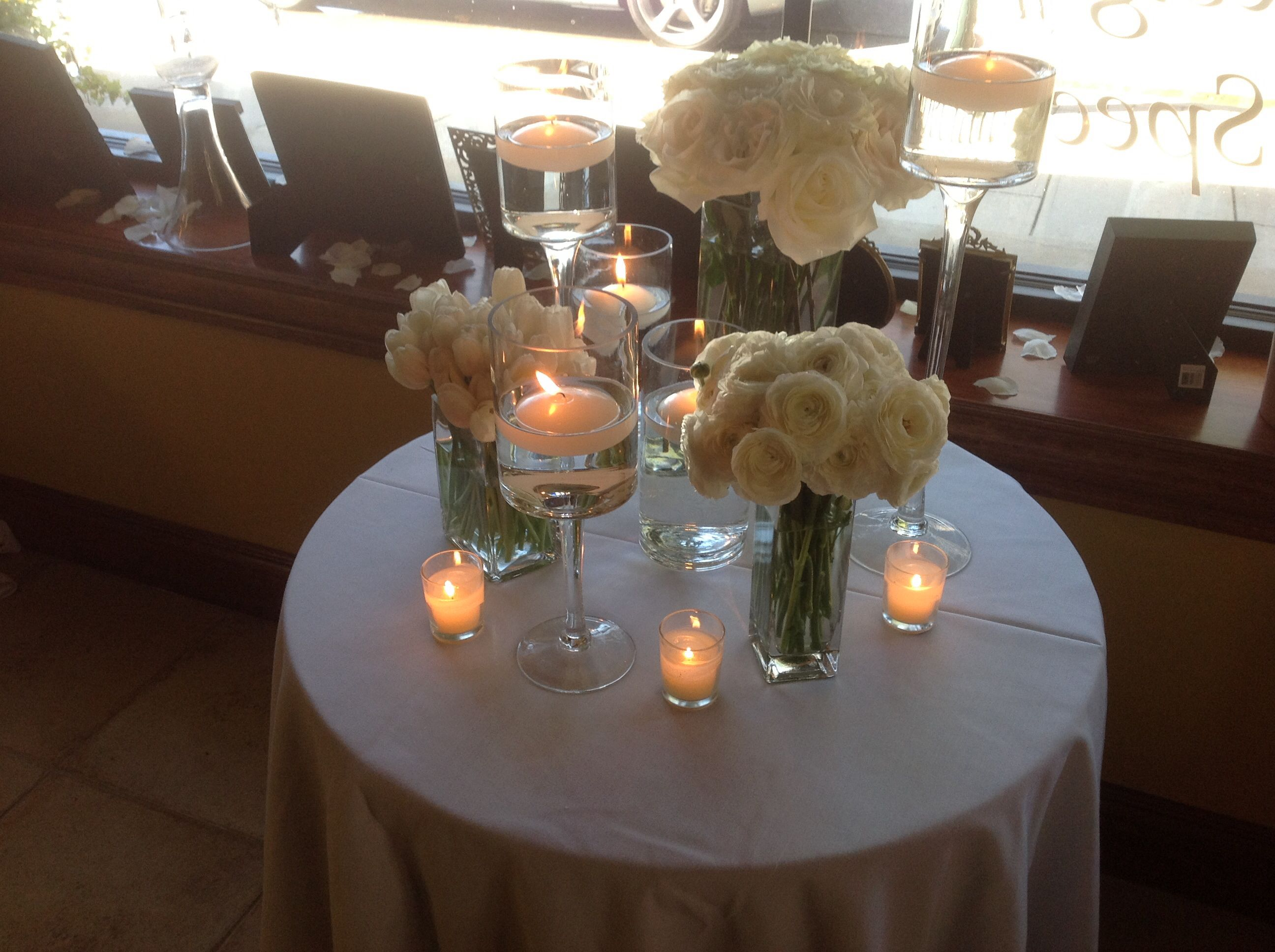 Wedding centerpiece of square vases filled with white