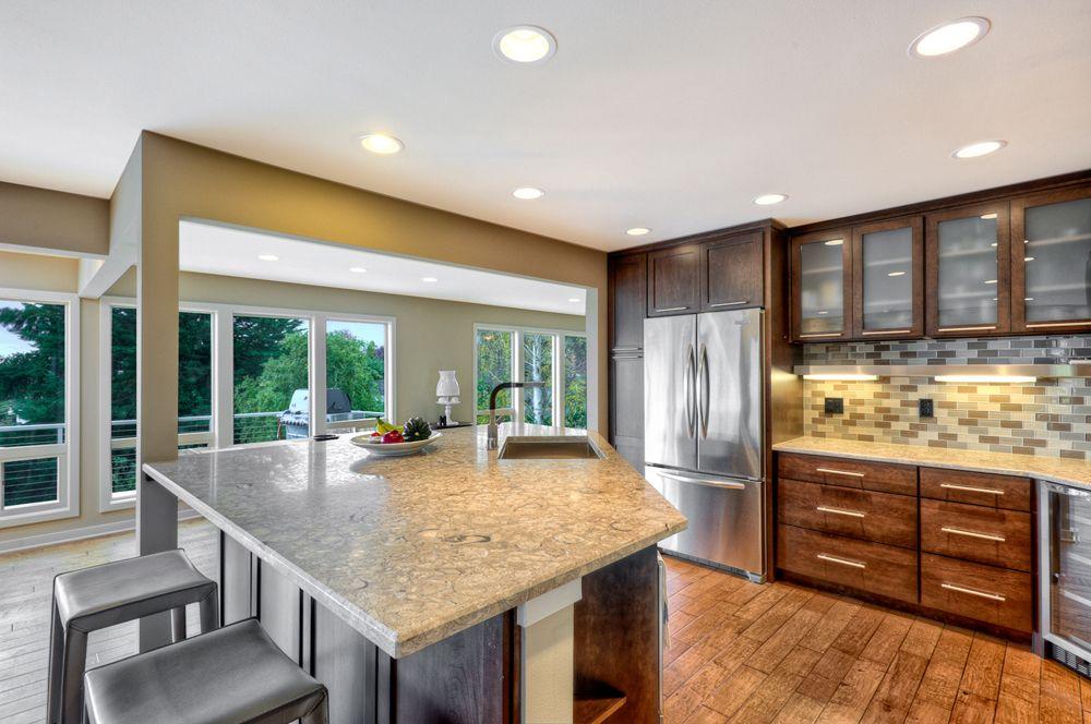 #KitchenRemodel In #DesMoines: Floor To Ceiling Windows, Granite Countertops,  Oak Cabinets
