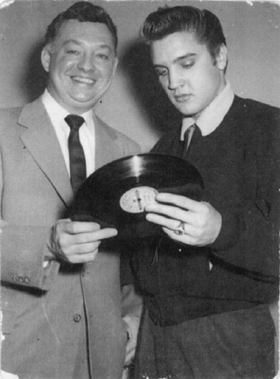 Elvis Holding A 78 Rpm SUN Record