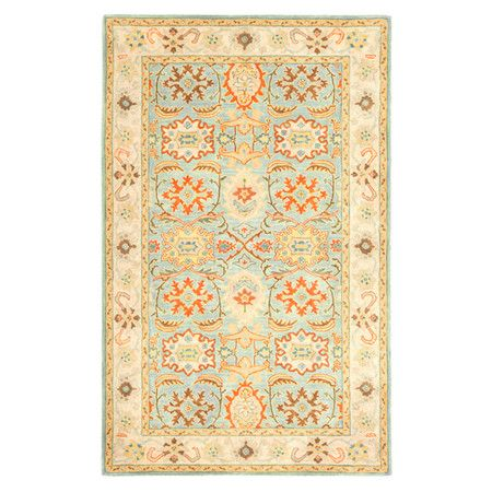 Anchor your living room seating group or define space in the den with this artfully hand-tufted wool rug, showcasing a Persian-inspired motif for classic app...