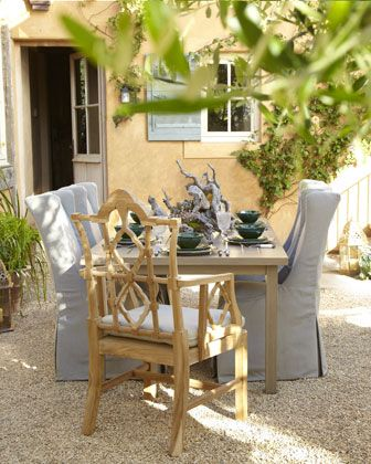 I'd love to come home to find this lovely layout in my backyard!   Outdoor Dining Furniture at Horchow.