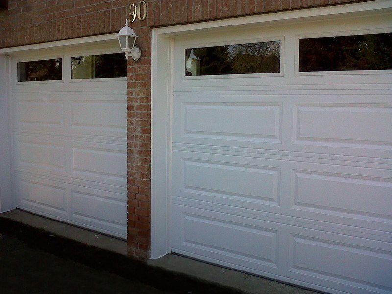 C H I Overhead Doors Model 4350 Steel Long Raised Panel Garage Doors In White With Plain Glass Garage Doors Residential Garage Doors Overhead Door