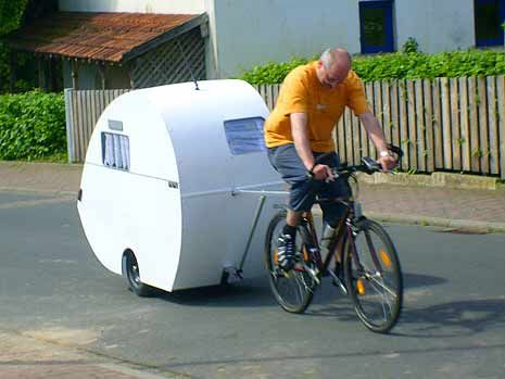 bicycle tear drop trailor being towed by a bicycle and a. Black Bedroom Furniture Sets. Home Design Ideas