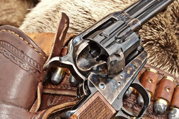 Cowboys with guns during the wild west