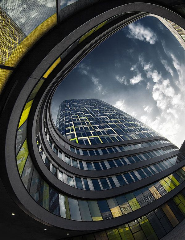 Urban Architecture Photography By Nick Frank. Low Angle Of Buisness  Building, Emphasizing The Swooping