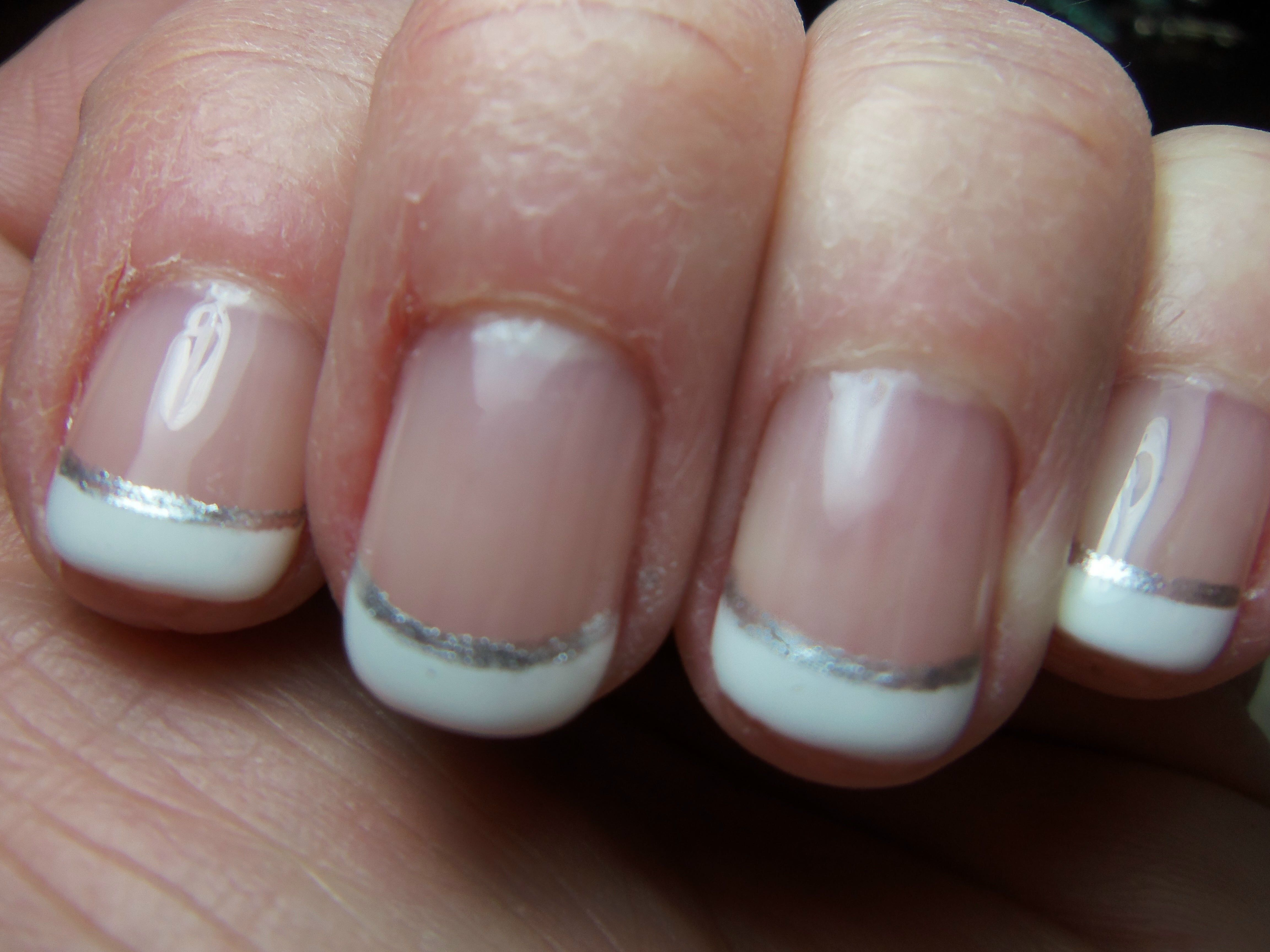 keep my nails very short. French gel manicure, clear polish with