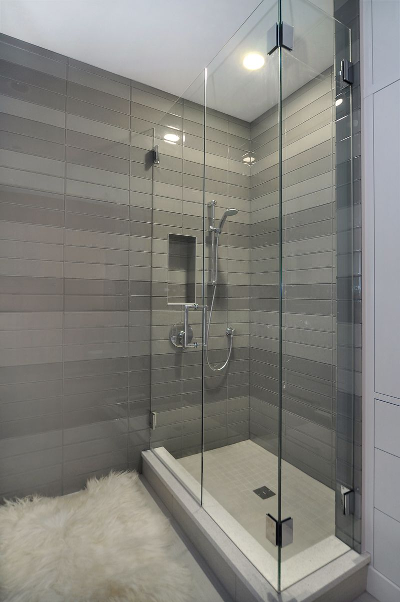 Contemporary shower with striped tile detail by johnson for Contemporary bathroom tiles
