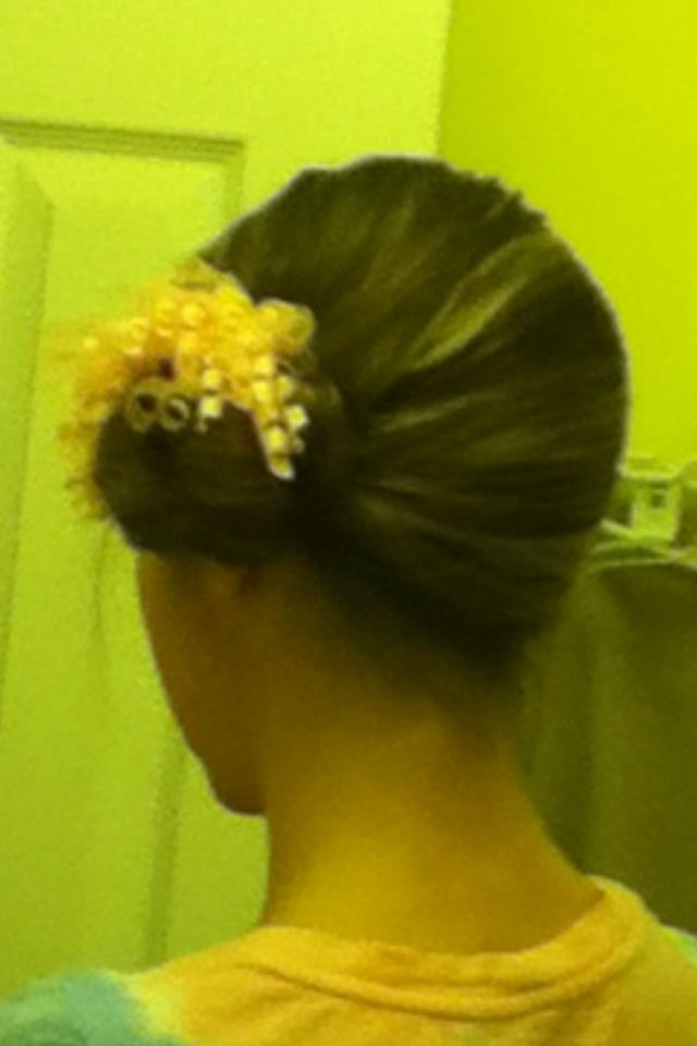 Wet hair... No problem! Twist it into a bun on the side of your head, tie off with a hair tie, and add a bow. Ta-da!