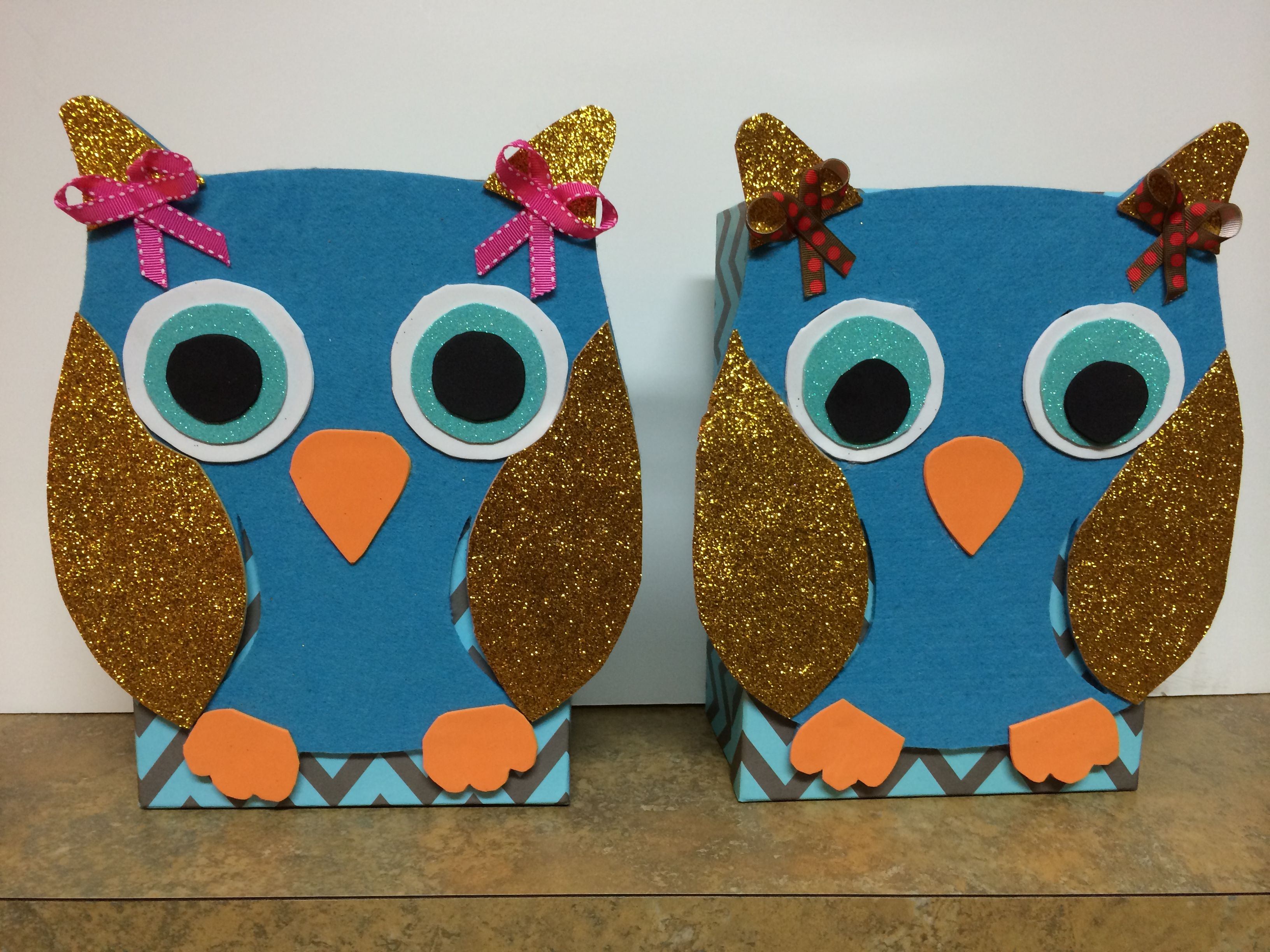 Owl Valentine's Day Boxes!    Bought the supplies for two boxes at Walmart for less than $15.  The boxes are photo boxes.  They sold a cut out owl (the blue background of the owl) for $2.  The rest is just foam paper hot glued together!  The first one we made, I glued the owl to the lid BEFORE cutting the foam paper.  This made it more difficult to get gold wings/ears the shape I wanted.  Would definitely recommend cutting out all shapes before hot gluing owl onto box!  :-)