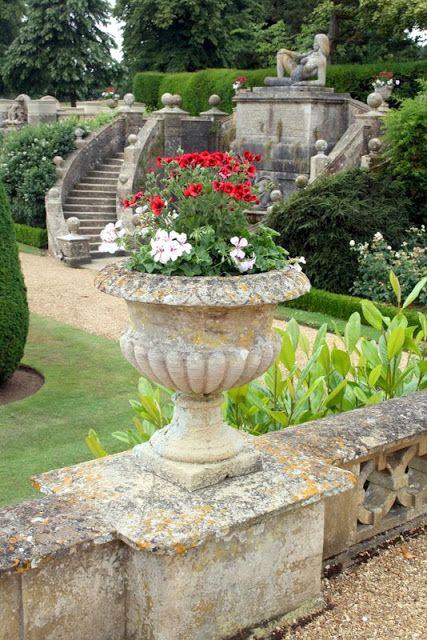 The Man In The Painting Garden Design English Garden Garden Urns