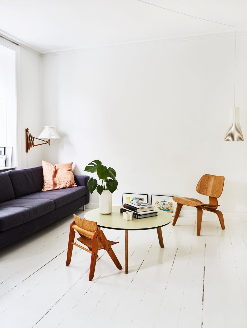 Spacious living room with white walls, floor and ceiling. | Living ...