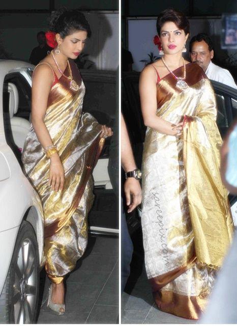Priyanka chopra in silk saree at Uday singh-Shirin morani wedding reception. She gave appearance in a gold zari kanjeevaram silk saree with gold zari borde
