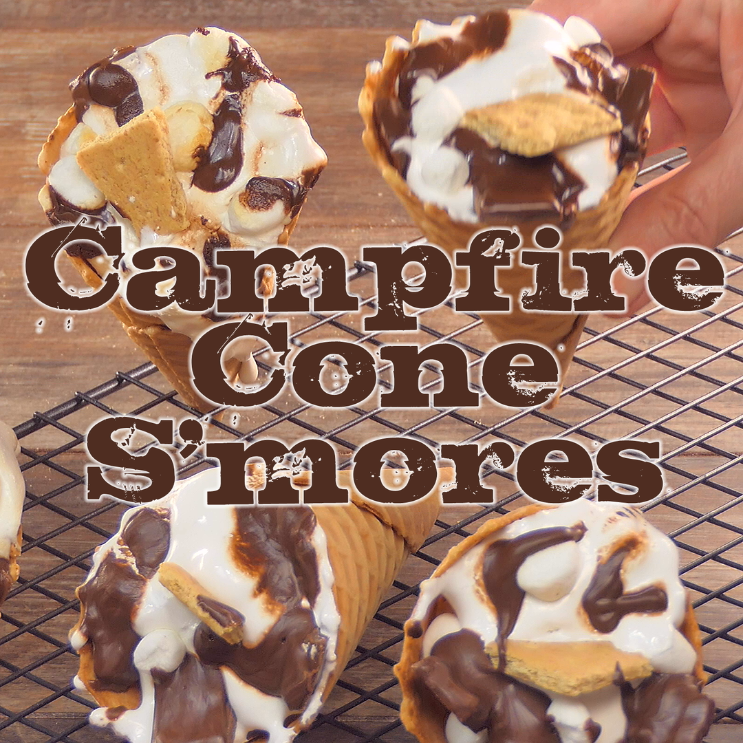 These Campfire Cone S'mores are a tasty variation on the traditions s'mores recipe and are a fun way to enjoy your favorite campfire treat! #chocolate #marshmallows #cones #smores #camping #grilled #dessert #recipe | bobbiskozykitchen.com #grilleddesserts