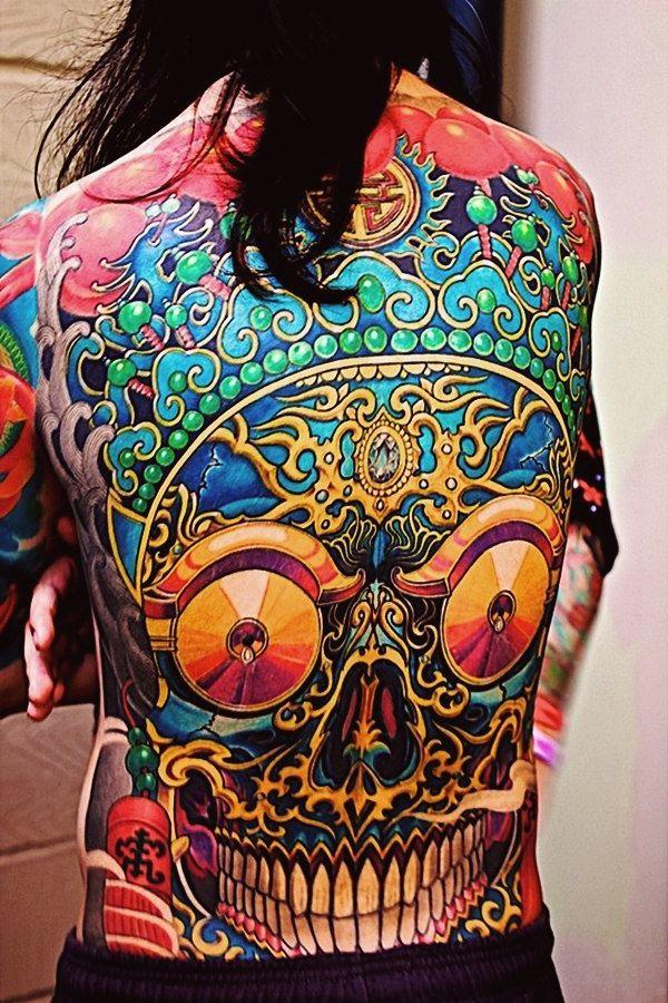 Ethnic scull new school tattoo idea on back back tattoos for Tattoo school listings