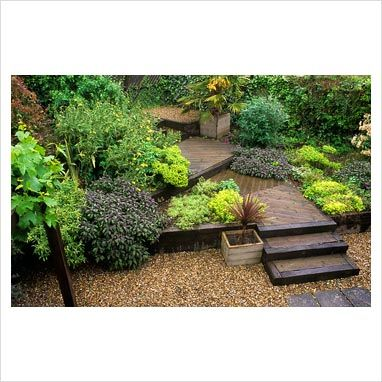 Multilevel deck interspersed with multi-level planters.