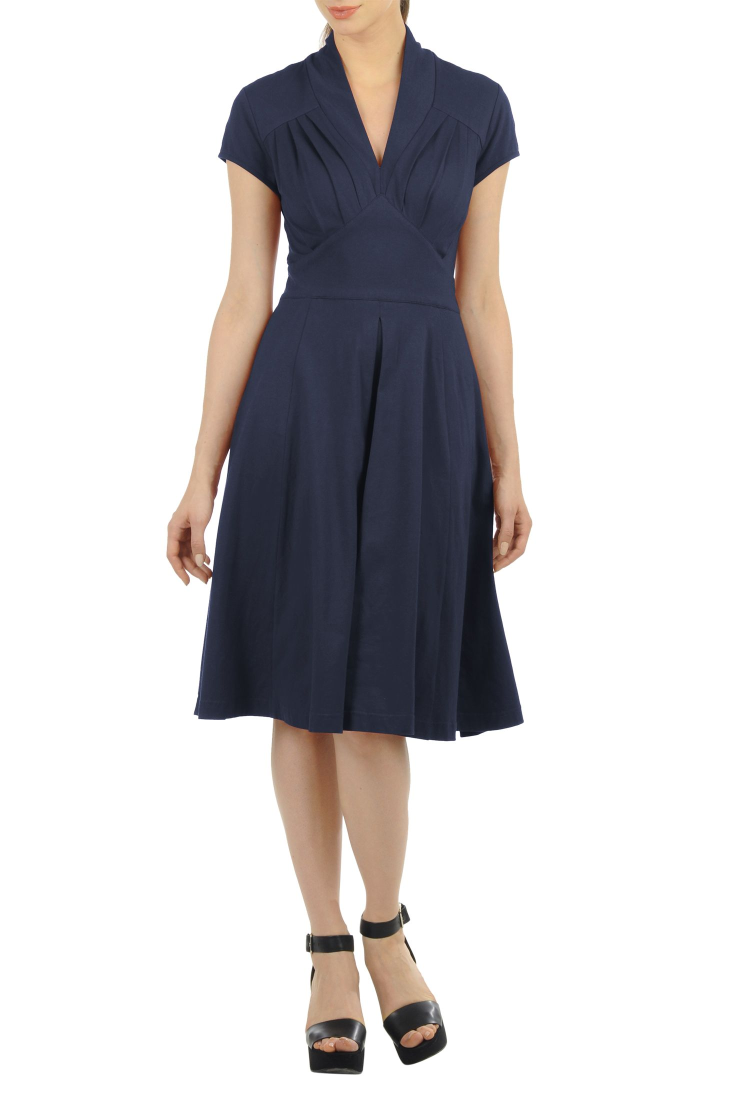 Soft cotton knit falls gracefully into the pleated bodice