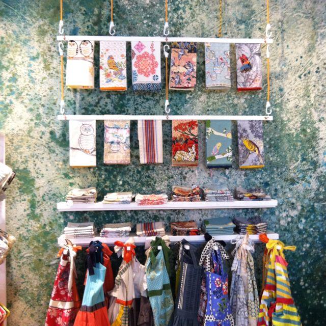 Pin By Thuis Met Moon On Visual Merchandising Tea Towel Display Retail Wall Displays