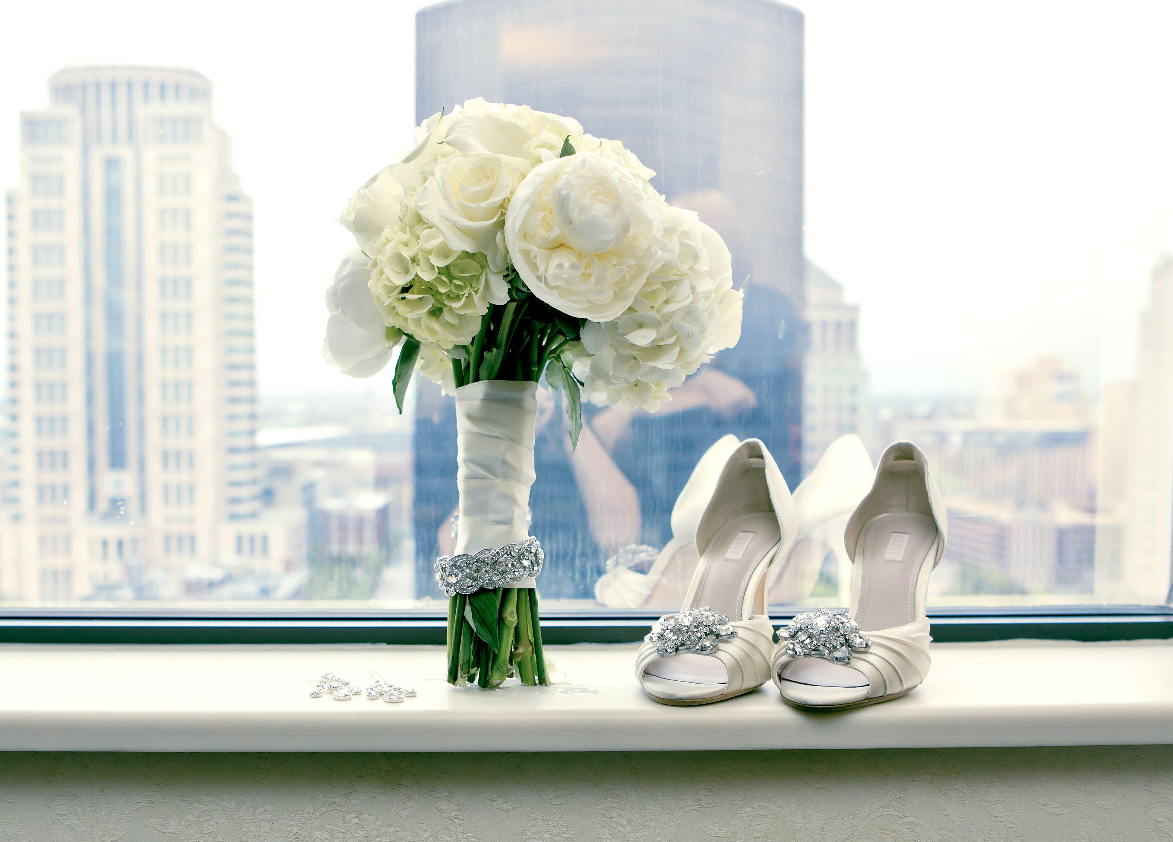 Wedding bouquet; white peonies, white hydrangeas, white roses, white calla lilies @SoulardFlorist