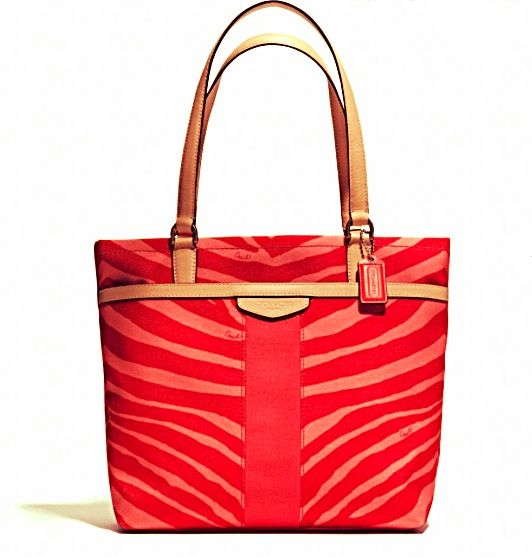 The Coach Strawberry Canvas and Leather Tote is a top 10 member favorite on  Tradesy. 88ecbdf46f448