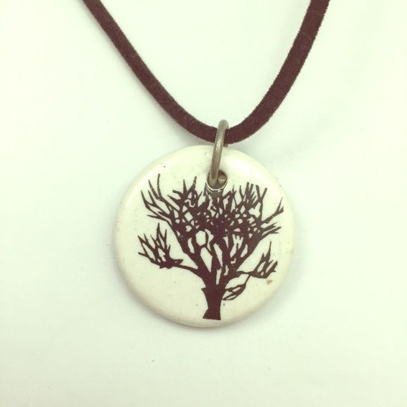 Tree necklace Beautiful ceramic pendant with tree design on a soft brown chain. You can easily change out the chain to whatever you like! Maybe a silver chain is more your style.  In good condition. The chain fabric has a little bend from the necklace being stored in a ziplock bag, but this will straighten out and look fine when worn. Don't forget to bundle and save 20%!  Jewelry Necklaces
