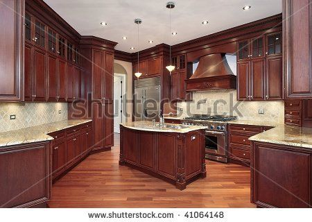 white countertops with cherry cabinets | kitchen with cherry wood