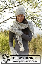 Ravelry: 141-23a Veronica - Hat and scarf with textured pattern in Nepal, pompoms in Vienna pattern by DROPS design