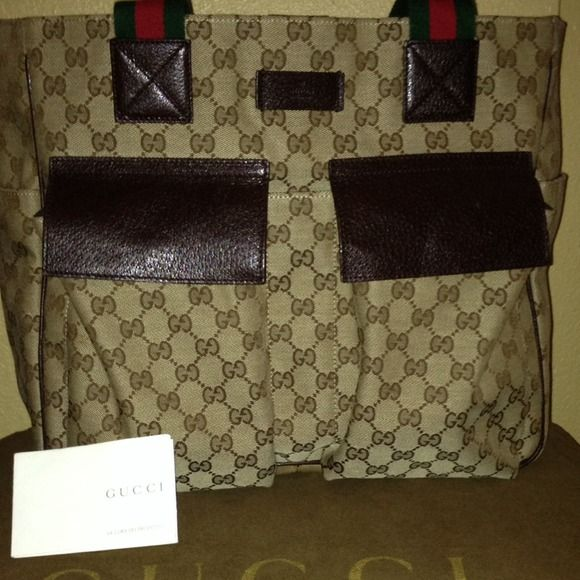 Authentic Gucci Medium Tote-Beige Signature GG Canvas Tote with 4 utility pockets on the exterior and two tech pockets with zipper pockets on the interior. In excellent condition and barely used. No rips, tears, frays or stains at all. Could make a great travel tote or work tote. Dust bag included Gucci Bags Totes