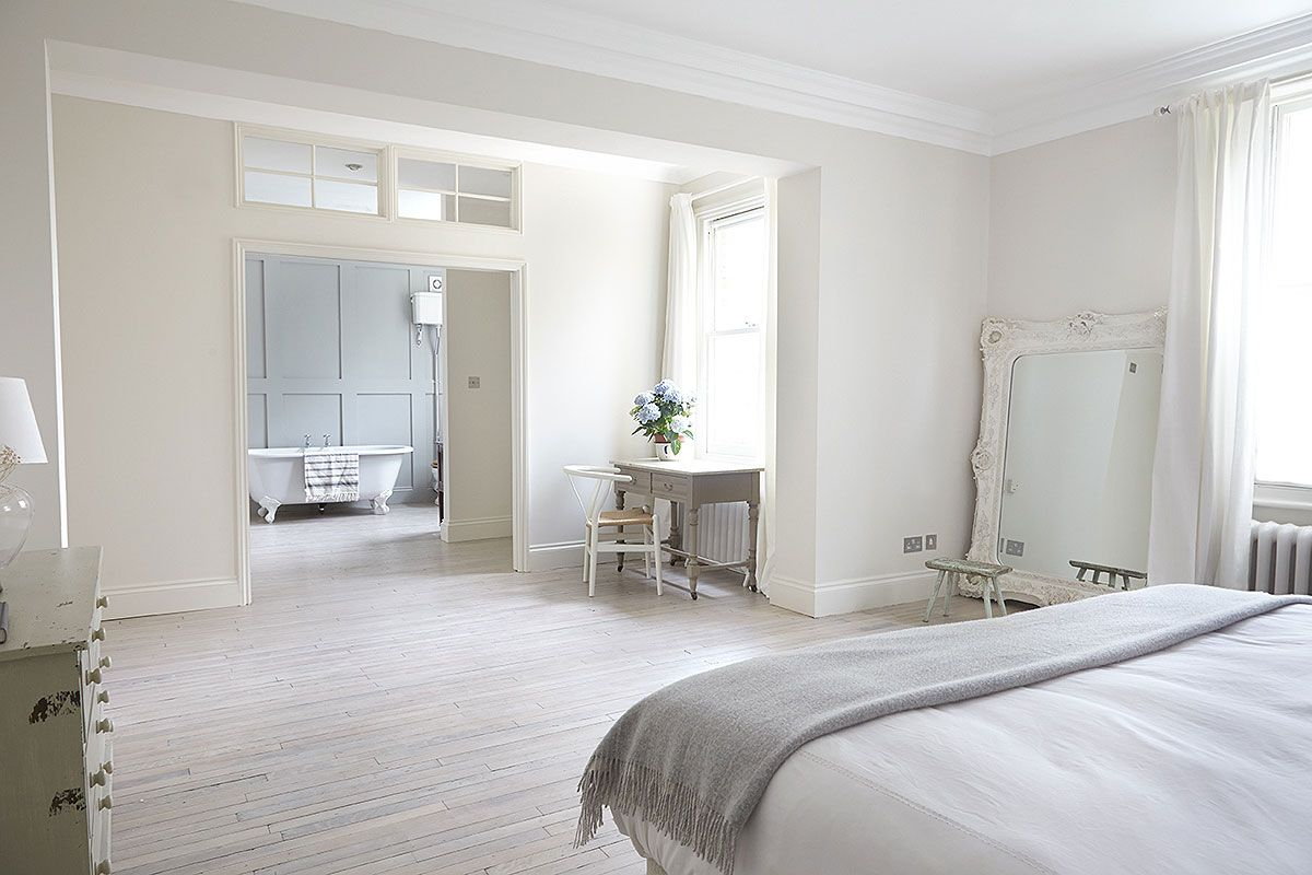 Tour a london home full of light tubs lights and bedrooms
